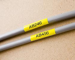Páska BROTHER TZE-S651 žlutá / černá 24mm